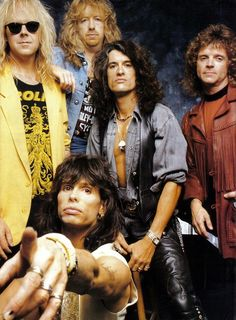 """Aerosmith was formed in Boston, Massachusetts in 1970 & is sometimes referred to as """"The Bad Boys from Boston."""" Guitarist Joe Perry and bassist Tom Hamilton, originally in a band together called the Jam Band, met up with vocalist/harmonica player Steven Tyler, drummer Joey Kramer, and guitarist Ray Tabano, and formed Aerosmith."""