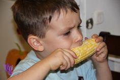 My kids enjoying Sweet Corn