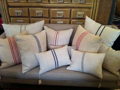 vintage grain sack pillows add simplistic style and are very in.