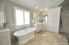 Honey Were Home: Our Master Bathroom She uses a Sherwin Williams color called Agreeable Grey which is similar to the Revere Pewter (i think) Her floor is a similar tan shade like the tile we have.