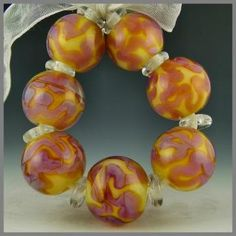 set of 7 round beads handmade lampwork glass pink purple pearl - Heatwave by PolychromeBeads for $30.00