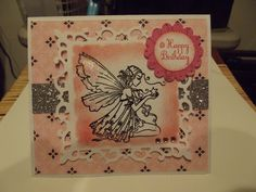 Lili of the Valley stamp, used spellbinders die and then distressed inside.