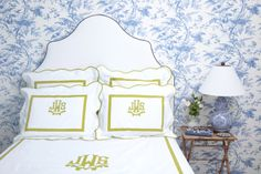 monogrammed bedding (serena & lily and leontine linens) and blue and white wall paper (shewrin williams)