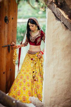 Bridal Wear - Yellow and Red Wedding Lehenga with Marsala Velvet Blouse and Net white Dupatta | WedMeGood #wedmegood #indianbride #indianwedding #lehenga #yellow #bridal #openhair #marsala