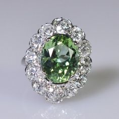 Magnificent mint tourmaline and diamond ring; platinum French ring setting. The stone weighs 5.75ct and is mounted with 3.50ct of Old European cut diamonds, C.1930.