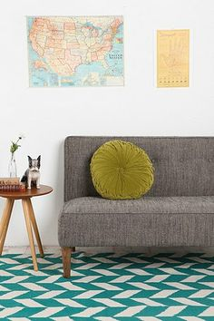 Love this rug pattern (comes in lots of colors); Also like the pillow, side table, and map.