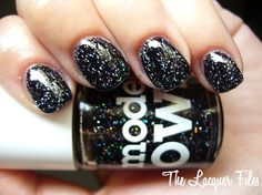 """models own """"mixed up"""" - clear base with small black glitter and large holo glitter"""