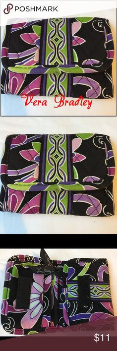 Vera Bradley Tri-Fold Wallet Vera Bradley Tri-Fold Wallet in Retired Purple Punch Pattern. Beautiful bold colors, used but in excellent condition. Size open 5x4 closed 5x10 1/2. Vera Bradley Bags Wallets