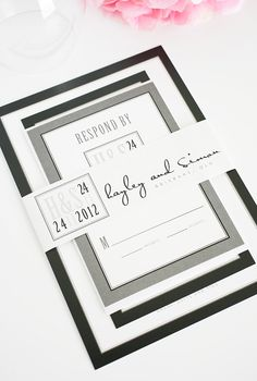 Mix of modern and traditional in these black and white wedding invitations