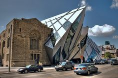 https://flic.kr/p/5jpo9J   The Michael Lee-Chin Crystal, Royal Ontario Museum, Toronto (IMGP4994)   Royal Ontario Museum, Toronto.  The magnificent glass and aluminium-clad addition designed by world-renowned architect Daniel Libeskind and named after the lead donor of the museum's renovation project.  The crysyal is designed to have no right-angles.