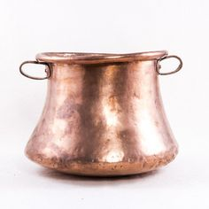 "Nineteenth century copper pot with two riveted copper handles. Ideal for a potted plant. 10"" H X 13"" Diameter"