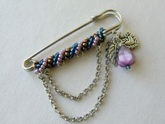 Purple Kilt Pin Charm Brooch Safety Pin Brooch Shawl Brooch Pins Winter Jewelry Seed Bead Brooch with Heart Charms and Leaf Charms. $24.00, via Etsy.
