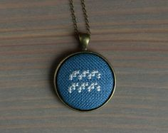 """Necklace with cross stitched zodiac sign. I've used dark blue fabric and silk silver threads. The pendant can have any of 12 zodiac signs.  • Pendant's approximate diameter is 3 cm / 1.2"""" •..."""