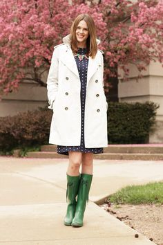 We approve of this rainy-day outfit donned by style blogger Jessica of What I Wore. When in doubt, a trench coat pairs perfectly with rain boots.
