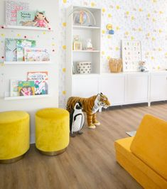 This entire playroom is a dream! And, we love how colorful it is.