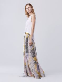 This maxi skirt in a painterly print can be dressed up with a shimmering bodysuit or worn on the weekend with your favorite sneakers. This no zip style features a front slit for ease of movement.