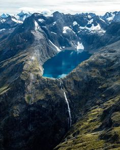 Fiordland National Park, New Zealand. Fiordland National Park occupies the southwest corner of the South Island of New Zealand. It is the largest of the 14 national parks in New Zealand, with an area of 12,500 km2, and a major part of the Te Wahipounamu World Heritage site. Photo by joeyschusler via Instagram #amitrips #travel #nature #newzealand
