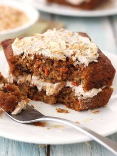 A moist toaster oven carrot cake stuffed with raisins, pecans, and pineapple, then covered with cinnamon cream cheese frosting and toasted coconut.