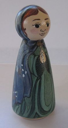 St. Brigid wooden doll by catholicfolktoys on Etsy