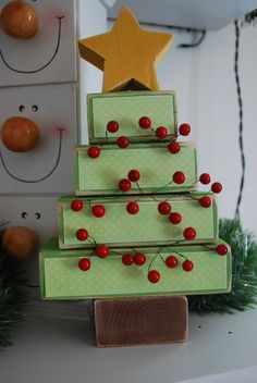 This christmas tree is adorable!! I like the snowmen in the background. Look for drawer cabinet and combine this look with the look from my muffin tin snowmen.