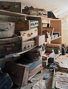 Abandoned Asylums by Christopher Payne) (All these suitcases would have belonged to the patients of the asylum. They hold all the possessions they brought with them to the hospital. Their suitcases would be unfortunately taken away, and stored in the attic. They are probably still full of cherished items of forgotten people.)