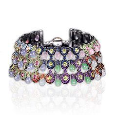 de GRISOGONO bracelet features nearly 300 carats of a variety of gemstones including sapphires, garnets, aquamarine and amethyst amongst others set in 18k white gold.