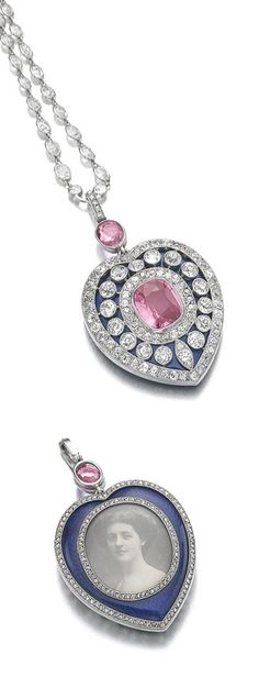 Pink sapphire, sapphire, enamel and diamond pendant/necklace, Cartier, 1911: The heart shaped pendant set with a cushion-shaped pink sapphire over blue enamel, highlighted with circular- and single-cut diamonds, the reverse with a sepia portrait photograph of a young woman within a rose diamond frame, over blue guilloché enamel, suspended from an oval pink sapphire and a chain spectacle-set with cushion-shaped and circular-cut diamonds, on a cushion-shaped sapphire clasp.