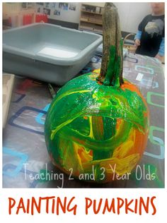 Toddlers love painting pumpkins and then washing them in the water table! - Teaching 2 and 3 Year Olds