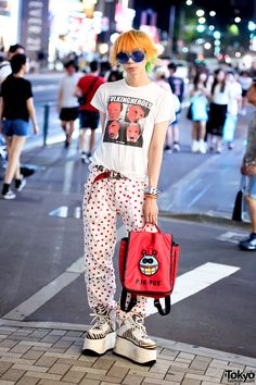 tokyo-fashion: Harajuku Fashion Walk organizer Junnyan on the street in Harajuku wearing a Milkboy top with Diet Butcher Slim Skin pants, Buffalo platforms, and a W&LT bag.
