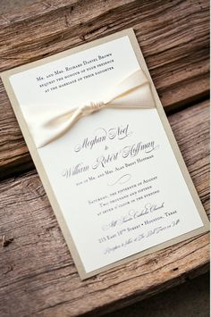 This wedding invitation was printed with black ink on metallic quartz paper with a gold leaf back layer and an ivory ribbon. Inked Invitations / Etsy