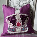 The Jubilee Damson Royal Collection Decorative Pillow by Designers Guild is a luxurious velvet applique and silk embroidered decorative pillow that features the State Crown celebrating the Queens Diamond Jubilee.   The Jubilee Damson decorative pillow has a delicate silk trim and a damson silk ground that highlights the crown in all its glory, the silk reverse features the Royal Collection embroidered crest.  Add a touch of England to your home with this luxurious and elegant Jubilee Da