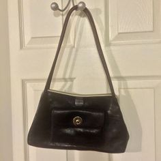 Genuine leather purse This smaller purse is absolutely lush with its soft black leather and red stitching detail. It has been gently loved and is in great condition. Wilsons Leather Bags Shoulder Bags