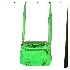 Steve Madden Crossbody NWOT! Perfect for spring and summer! This vibrant handbag is every girls dream with a pocket in the front and two different large compartments inside PLUS another small pocket inside! The inside navy and white lined pattern is classy and preppy and is such a fun addition to any bag-a-holic's collection! This rich green color will add a pop to any spring and summer outfit. Steve Madden Bags Crossbody Bags