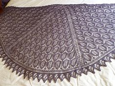 Night Garden shawl is a semi-circular shawl knitted from the centre top outwards, with three segments of leaf lattice pattern and a knitted on oak leaf border. FREE