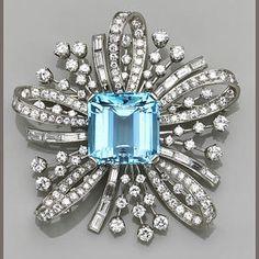 An aquamarine, diamond and platinum spray brooch