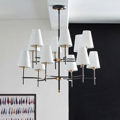 The Arc Mid-Century Chandelier brings the classic style of the '50s and '60s overhead. An antique bronze finish and an adjustable hanging height will easily adapt to any living room, dining room or bedroom.