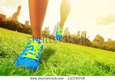 Runner - running shoes closeup of woman barefoot running shoes. Female jogging in Central Park, New York City. by Maridav, via ShutterStock