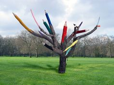 Dave Rittinger - Color Pencil Tree (2011) - carved tree and pigment (finished installation below)