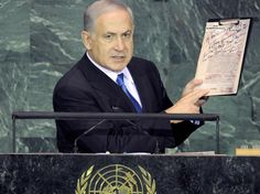 Israeli Prime Minister Benjamin Netanyahu holds up copies of Nazi plans for the Holocaust at the UN General Assembly, 24 September 2009.