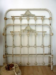 Crystal and Crates Vintage Rentals even has an Antique iron headboard. Green patina - use your imagination !