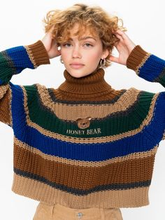 "Oversized Knit Jumper Cotton Blend Yarn Contrast Stripes Embroidered Slogan Roll Turtle Neck Long Sleeve Available in XS/S, M/L Hand Wash Cold Made in Europe Model wears size XS/S and is 175cm / 5'8"" tall"