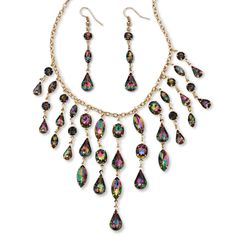 """The unique personality of the mystic crystals in this lucite jewelry set is perfect for the fashionista in you. Dramatic, ever-changing and luminescent, the marquise, pear, round and oval stones will mesmerize you with their fiery allure. Includes adjustable 17"""" - 20"""" bib necklace and 2 1/4"""" drop earrings. Gold tone."""
