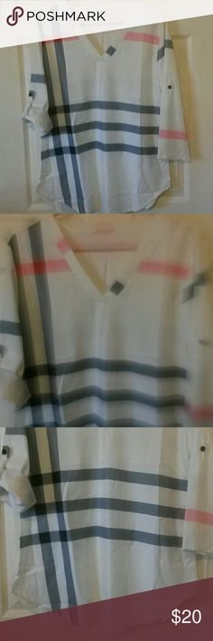 """NWOT! Plaid pattern V-neck Top Off-white with black, gray, pink, & red plaid-like pattern. Material is polyester, but kinda has a """"silk"""" look to it.  I purchased this top in an XL but it fits like a Medium-Large, so it's never been worn. There's a small black mark on the bottom of left sleeve; but I have never washed it so it may come out. It's a really cute top! Tops Blouses"""
