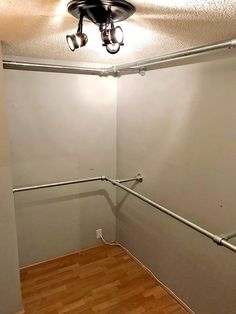 walk in closet DIY Walk In Closet Plans (with Step-by-Step Instructions) Pipe Shelves, Closet Shelves, Wall Mounted Shelves, Wood Shelves, Diy Walk In Closet, Pipe Closet, Master Closet, Wall Mounted Clothing Rack, Industrial Closet