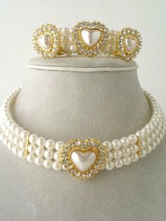 Fashion Jewelry ~ Goldtone Cream Color Faux Pearls with Heart Rhinestones Choker Set ~ Necklace, Clip on Earrings and Cuff Bracelet by Variety Gift Shop Fashion Jewelry. $19.95. pearl/ rhinestone/ adj./ clip on earring/ cuff bracelet. Save 60% Off!