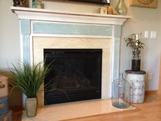 Fireplace mantle & surround refinished using CeCe Caldwell Simply White & Custom Mix (egg blue).https://www.facebook.com/Laparisiennevintagechic