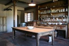 English country kitchen..  oh, makes me want to get in there and cook something up.  With a cup of tea, of course. :)
