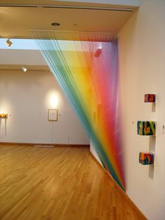 Gabriel Dawe, Mexican artists, now lives in TX. Rainbow installations are done with sewing thread.