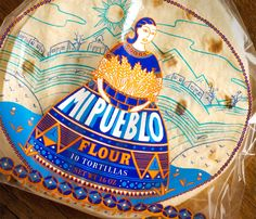 """In order to capture the essence of small Mexican villages, this in-store  brand of tortillas was named Mi Pueblo (My Town). The sense of community is  reinforced with the use of original illustration and traditional images."""