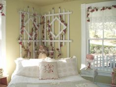 What a great and inexpensive idea for a unique headboard!  I could do without the pink flowers and maybe add some drapey ecot fabric.